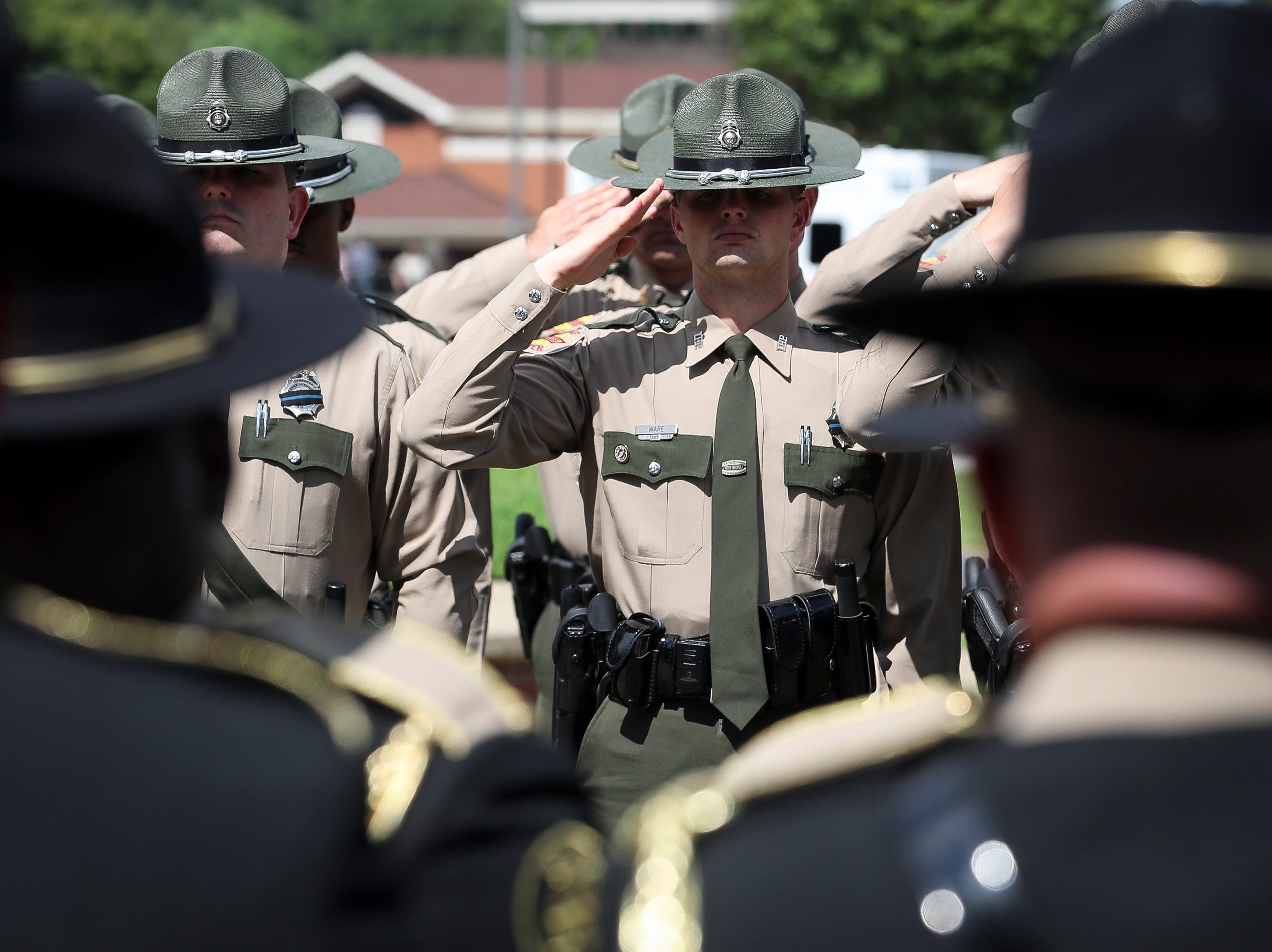 Tennessee State Troopers salute as the casket is carried out after the funeral service for Tennessee State Trooper Matthew Gatti at West Jackson Baptist Church in Jackson, Tenn., Monday, May 13, 2019. Gatti died in the line of duty in an accident while responding to a car fire on I-40 in Madison County on May 6.