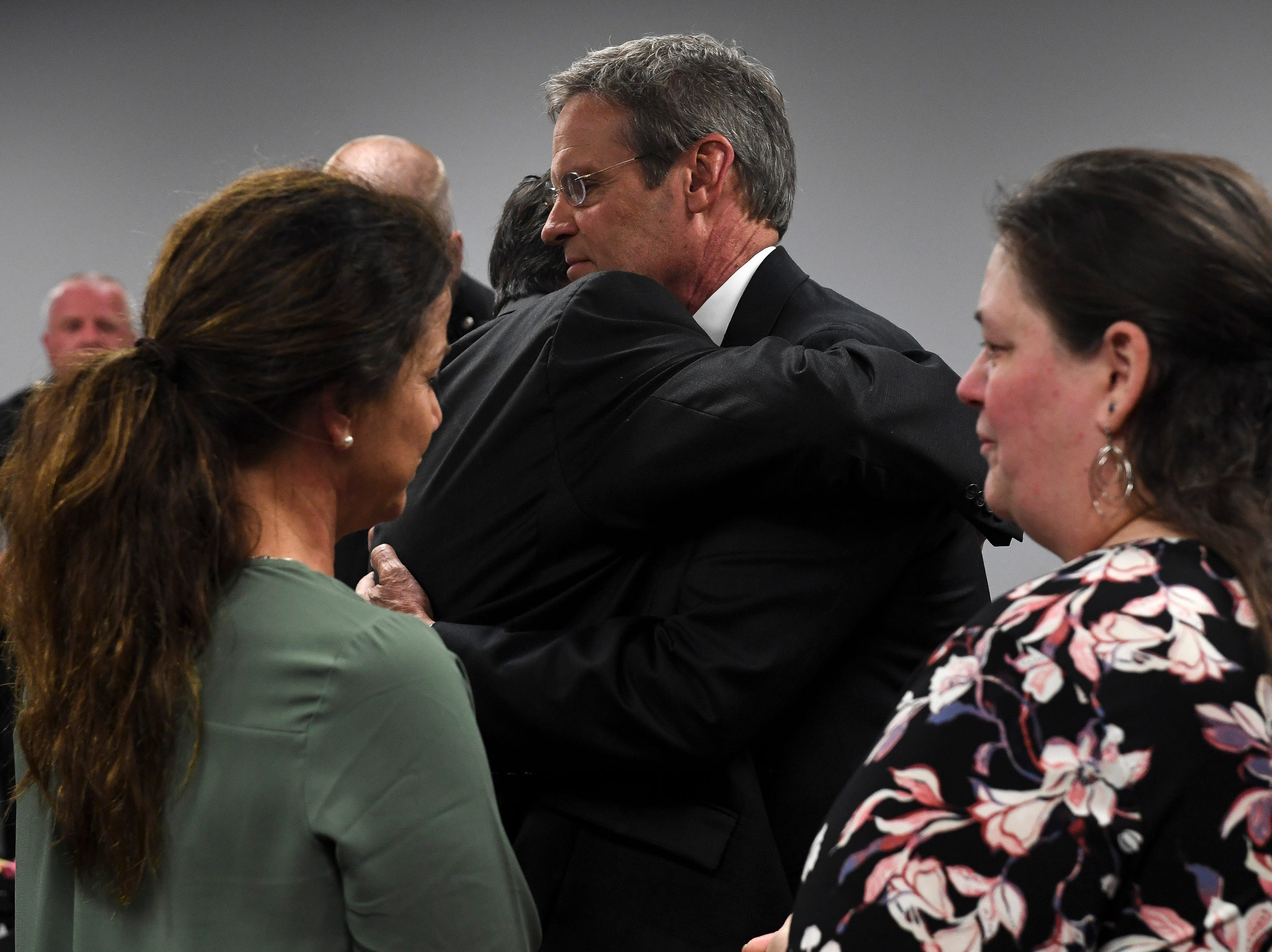 Tennessee Governor Bill Lee hugs Chris Gatti, father of Matthew Gatti, as first lady Maria Lee, left, chats with Christy Gatti, mother of Matthew Gatti, before the funeral service for Tennessee State Trooper Matthew Gatti at West Jackson Baptist Church in Jackson, Tenn., Monday, May 13, 2019. Gatti died in the line of duty in an accident while responding to a car fire on I-40 in Madison County on May 6.