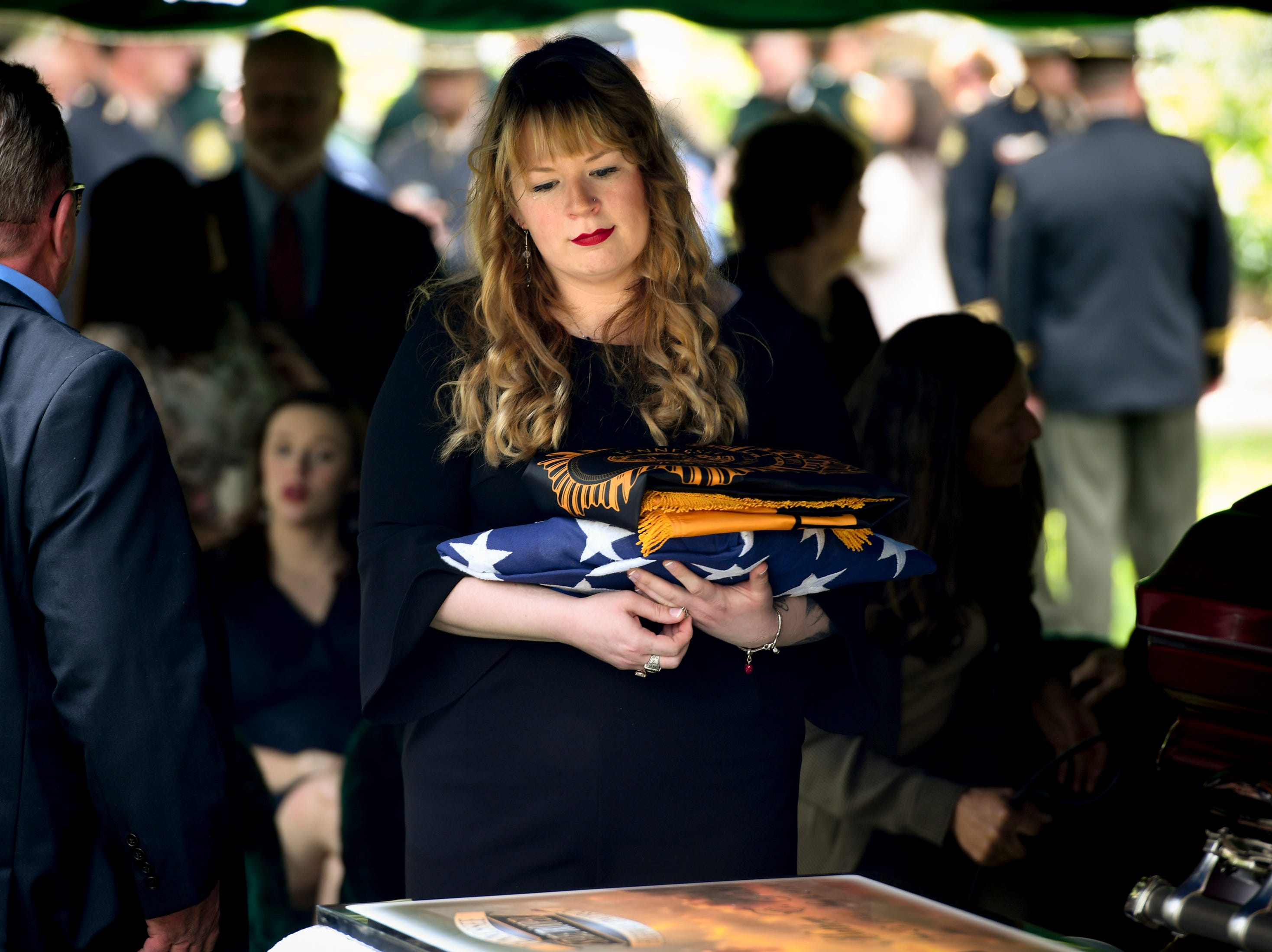 Anna Lax Gatti, wife of Matthew Gatti,  looks at her husband\s casket during the burial of Tennessee State Trooper Matthew Gatti at Ridgecrest Cemetery in Jackson, Tenn., Monday, May 13, 2019. Gatti died in the line of duty in an accident while responding to a car fire on I-40 in Madison County on May 6.