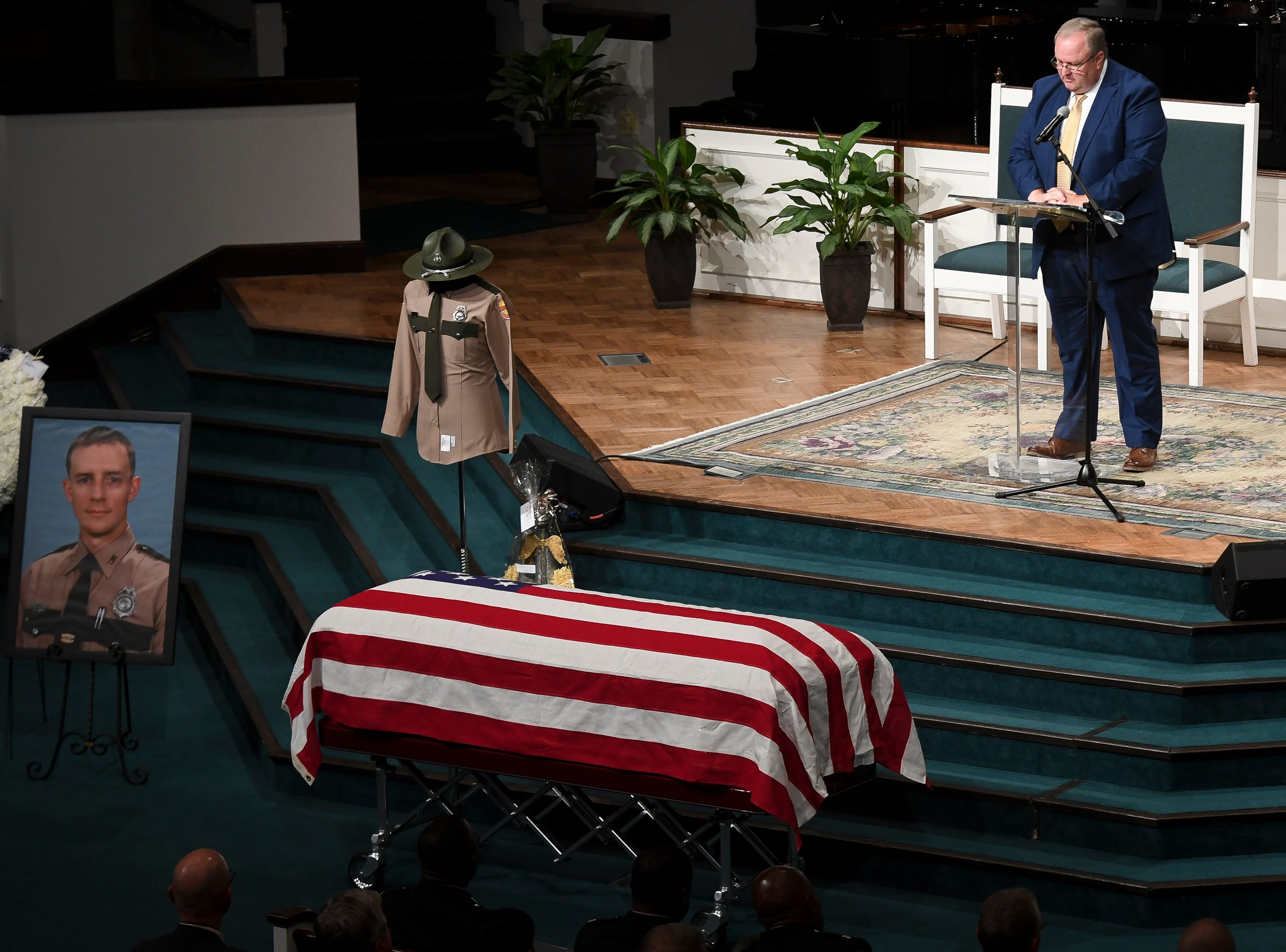 Rev. Wade Cash reads the obituary during the funeral service for Tennessee State Trooper Matthew Gatti at West Jackson Baptist Church in Jackson, Tenn., Monday, May 13, 2019. Gatti died in the line of duty in an accident while responding to a car fire on I-40 in Madison County on May 6.