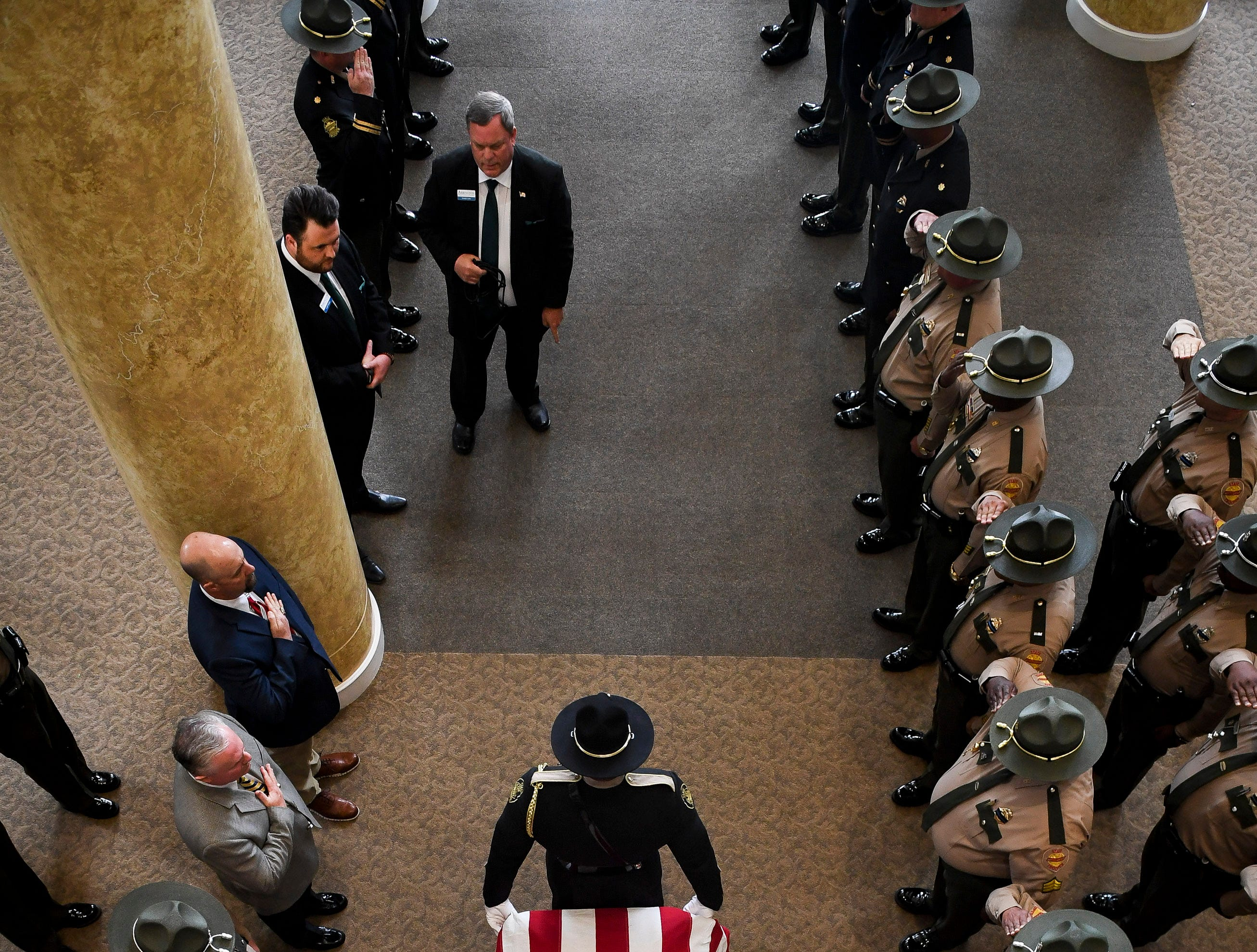 The casket is carried out after the funeral service for Tennessee State Trooper Matthew Gatti at West Jackson Baptist Church in Jackson, Tenn., Monday, May 13, 2019. Gatti died in the line of duty in an accident while responding to a car fire on I-40 in Madison County on May 6.