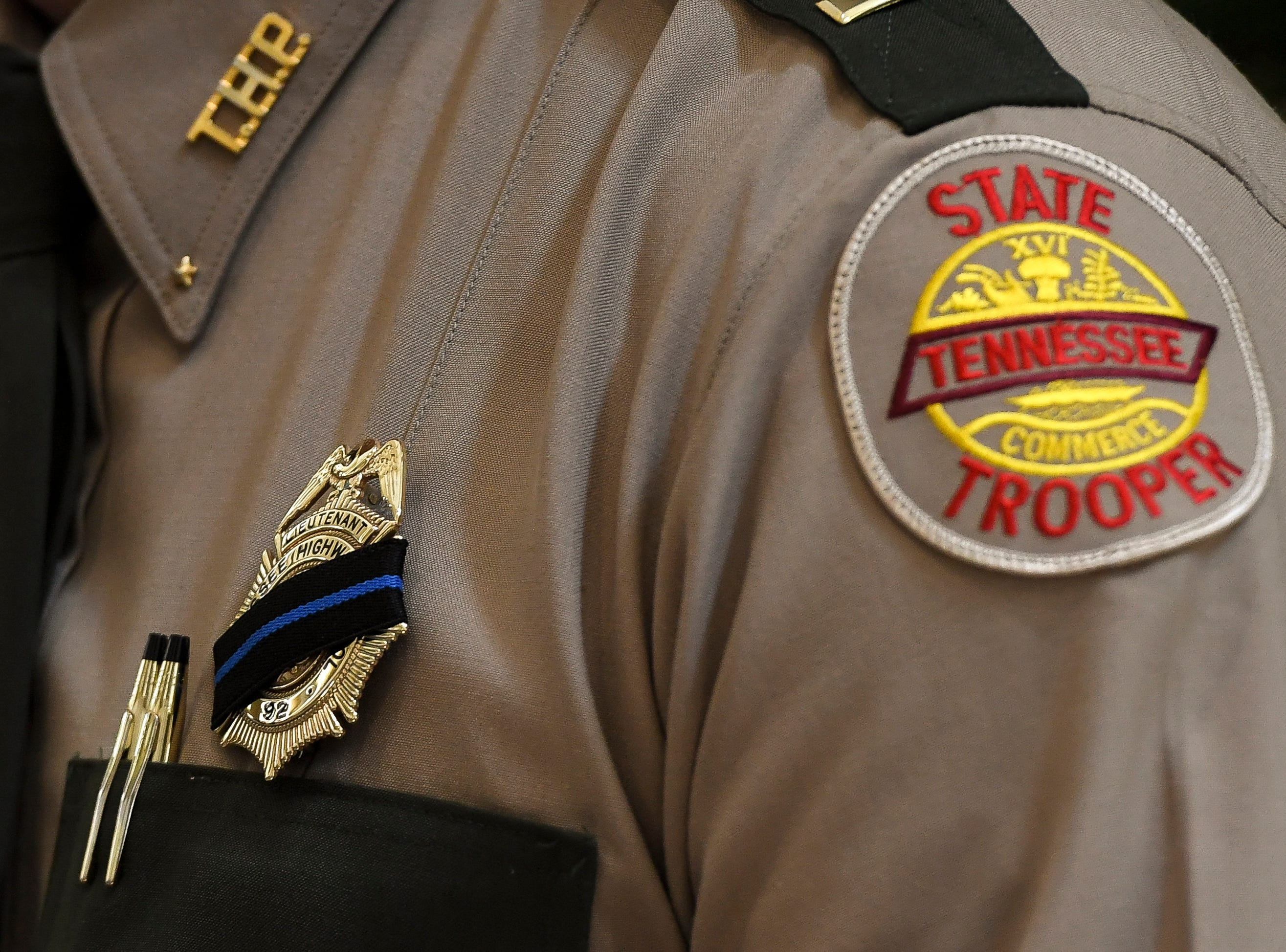 A Tennessee State Trooper wears a mourning band on his badge before the funeral service for Tennessee State Trooper Matthew Gatti at West Jackson Baptist Church in Jackson, Tenn., Monday, May 13, 2019. Gatti died in the line of duty in an accident while responding to a car fire on I-40 in Madison County on May 6.