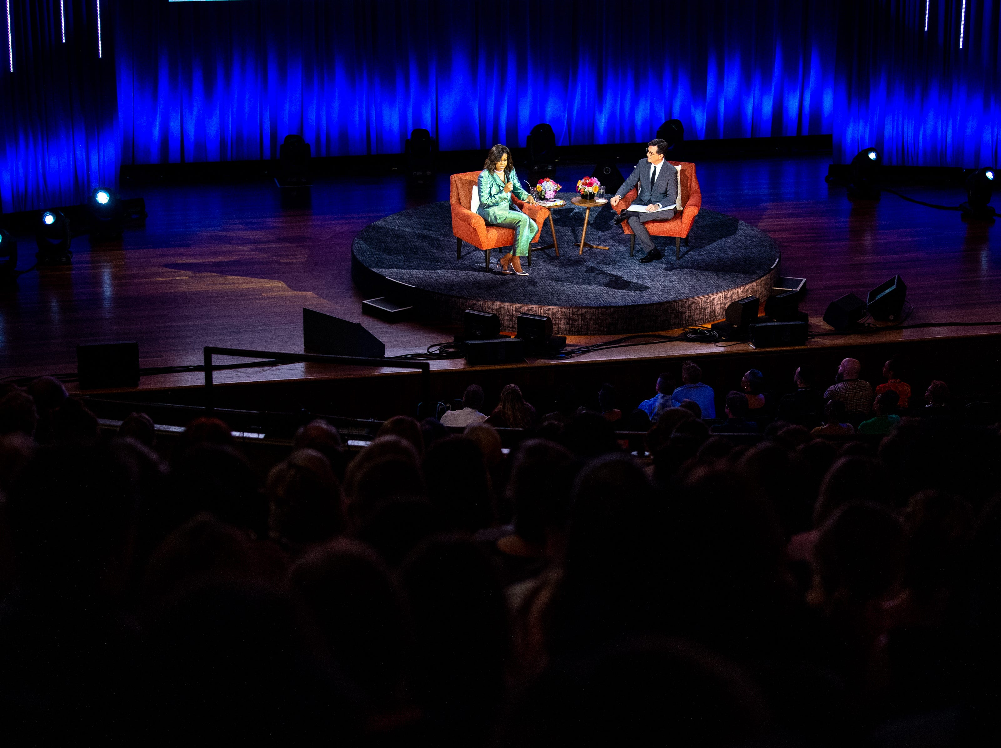 Michelle Obama speaks with Stephen Colbert during her Becoming: An Intimate Conversation with Michelle Obama event at Ryman Auditorium Sunday, May 12, 2019, in Nashville, Tenn.