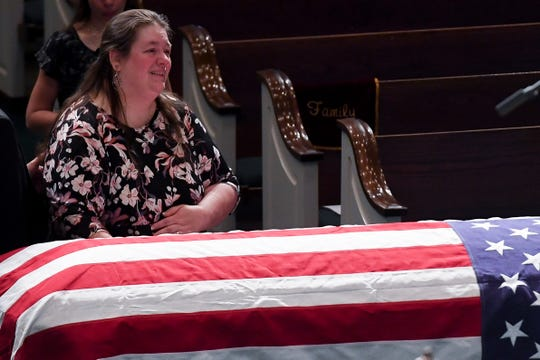 Christy Gatti, mother of Matthew Gatti, looks up at projected photos of her son before the funeral service for Tennessee State Trooper Matthew Gatti at West Jackson Baptist Church in Jackson, Tenn., Monday, May 13, 2019. Gatti died in the line of duty in an accident while responding to a car fire on I-40 in Madison County on May 6.