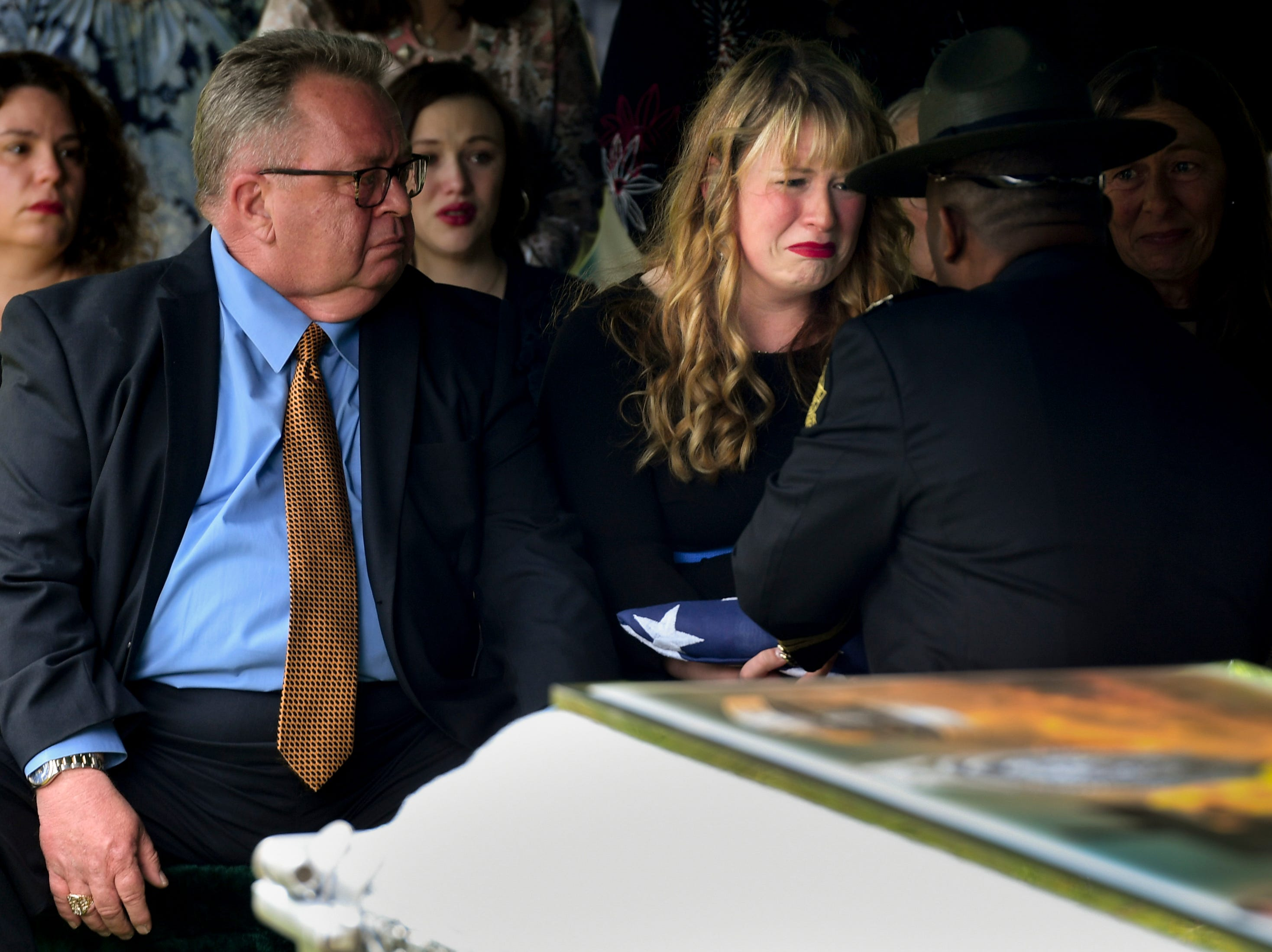 The flag is presented to Anna Lax Gatti, wife of Matthew Gatti, during the burial of Tennessee State Trooper Matthew Gatti at Ridgecrest Cemetery in Jackson, Tenn., Monday, May 13, 2019. Gatti died in the line of duty in an accident while responding to a car fire on I-40 in Madison County on May 6.