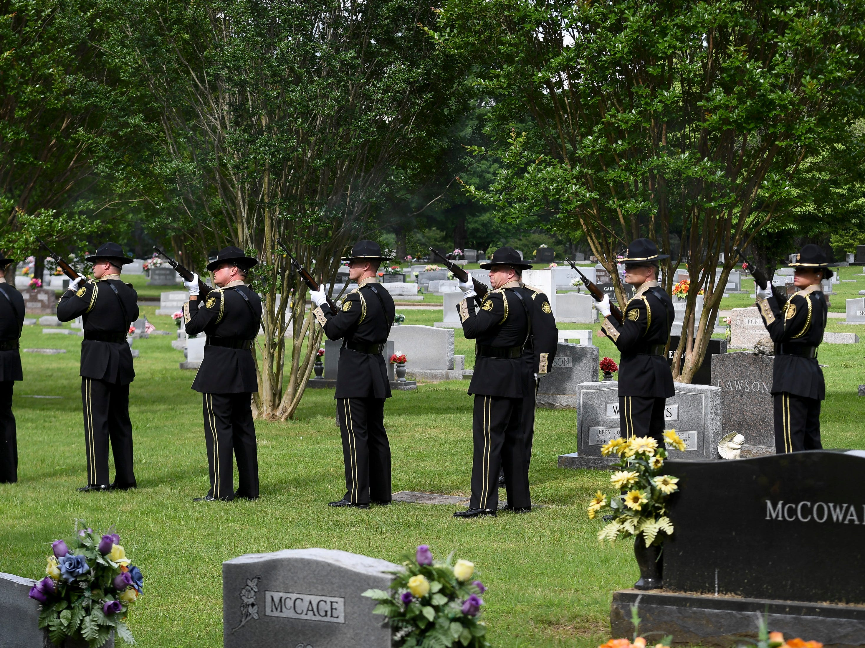 The honor guard fires a 21 gun salute during the burial of Tennessee State Trooper Matthew Gatti at Ridgecrest Cemetery in Jackson, Tenn., Monday, May 13, 2019. Gatti died in the line of duty in an accident while responding to a car fire on I-40 in Madison County on May 6.