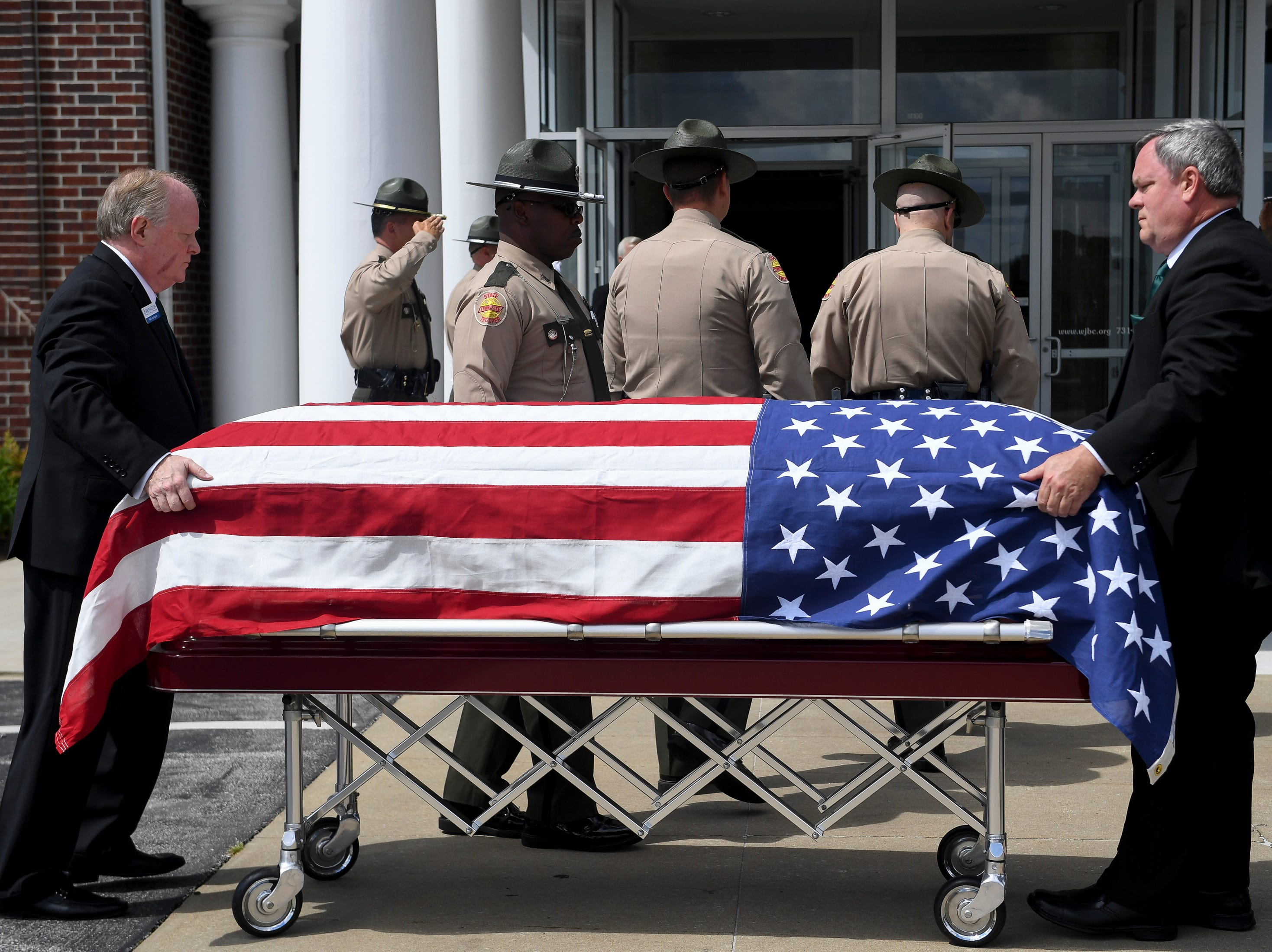 The casket is carried in before the funeral service for Tennessee State Trooper Matthew Gatti at West Jackson Baptist Church in Jackson, Tenn., Monday, May 13, 2019. Gatti died in the line of duty in an accident while responding to a car fire on I-40 in Madison County on May 6.