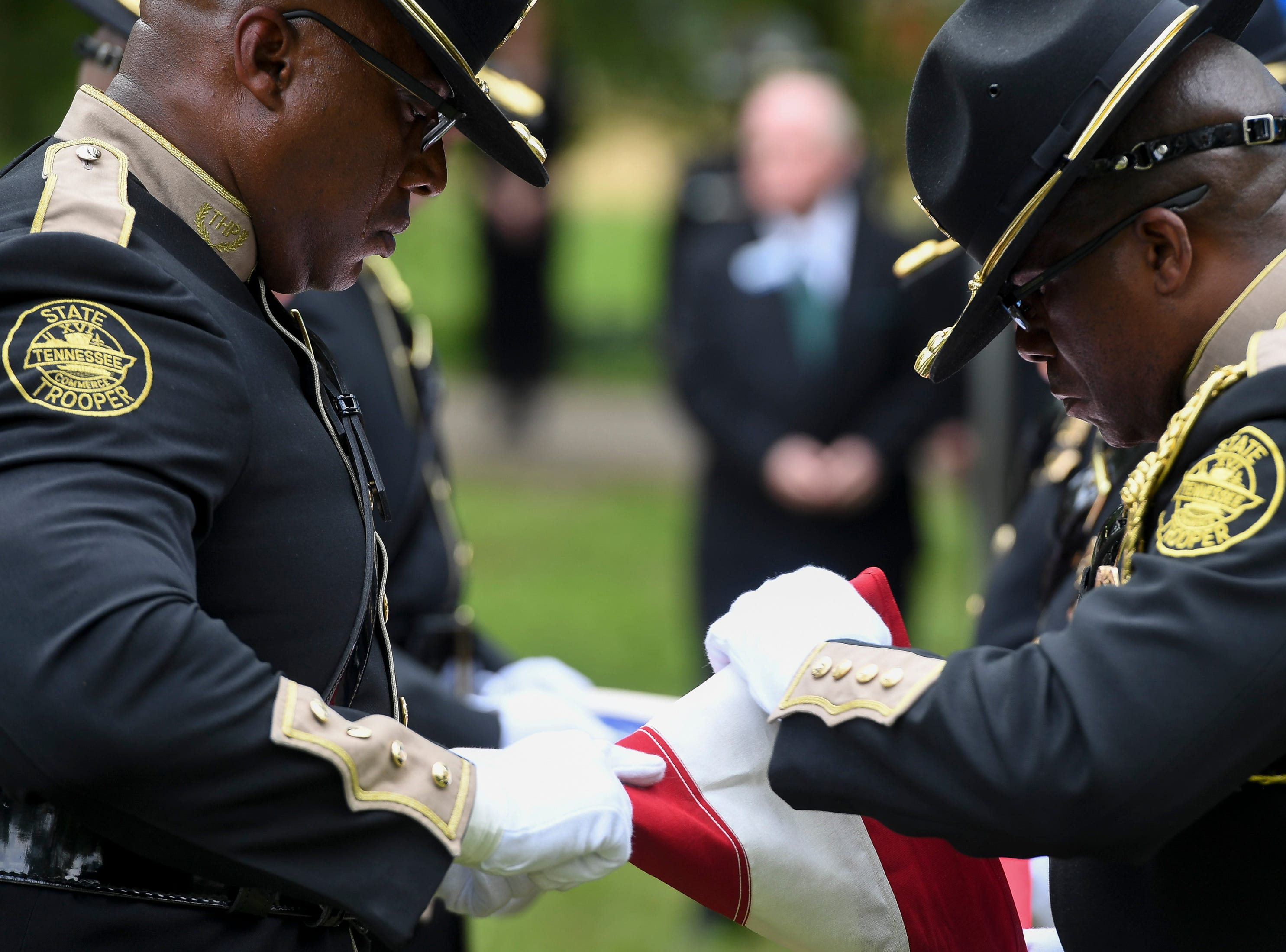 The honor guard folds the flag during the burial of Tennessee State Trooper Matthew Gatti at Ridgecrest Cemetery in Jackson, Tenn., Monday, May 13, 2019. Gatti died in the line of duty in an accident while responding to a car fire on I-40 in Madison County on May 6.