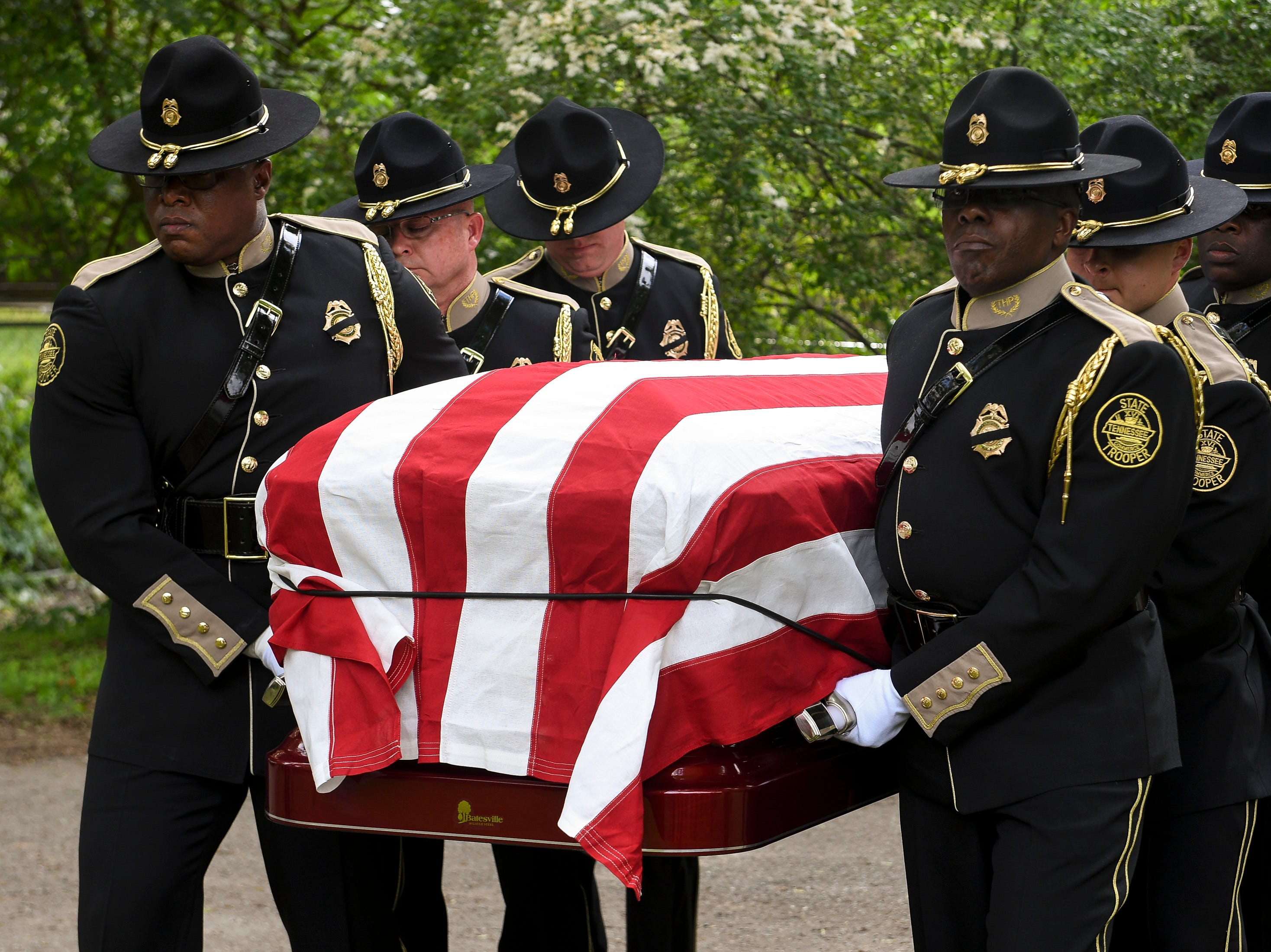 Tennessee State Trooper Matthew Gatti's casket is carried from the hearse at Ridgecrest Cemetery in Jackson, Tenn., Monday, May 13, 2019. Gatti died in the line of duty in an accident while responding to a car fire on I-40 in Madison County on May 6.