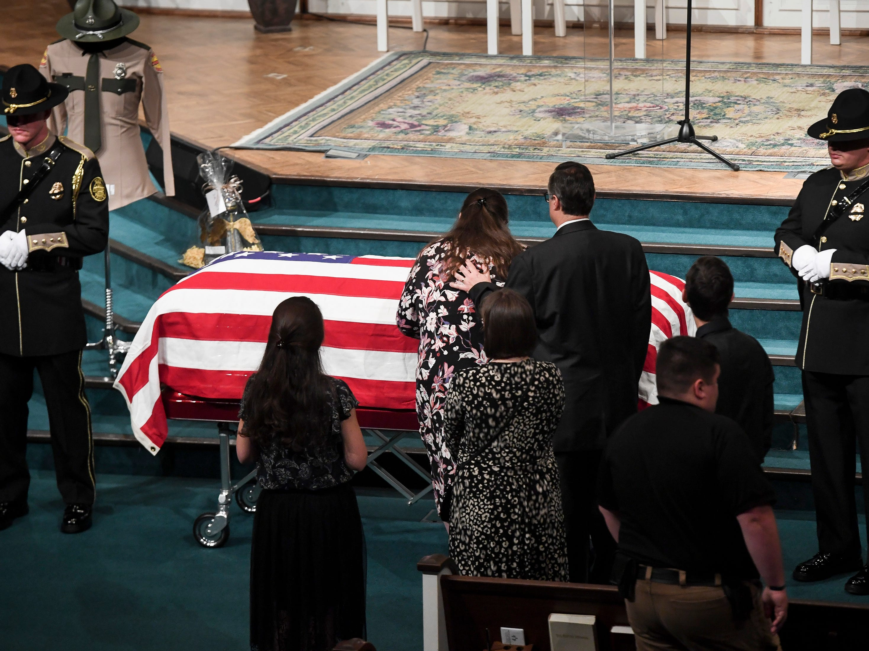 Christy Gatti and  Chris Gatti view their son's casket before the funeral service for Tennessee State Trooper Matthew Gatti at West Jackson Baptist Church in Jackson, Tenn., Monday, May 13, 2019. Gatti died in the line of duty in an accident while responding to a car fire on I-40 in Madison County on May 6.