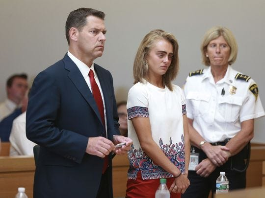 Michelle Carter listens to her sentencing for involuntary manslaughter for encouraging 18-year-old Conrad Roy III to kill himself in July 2014.
