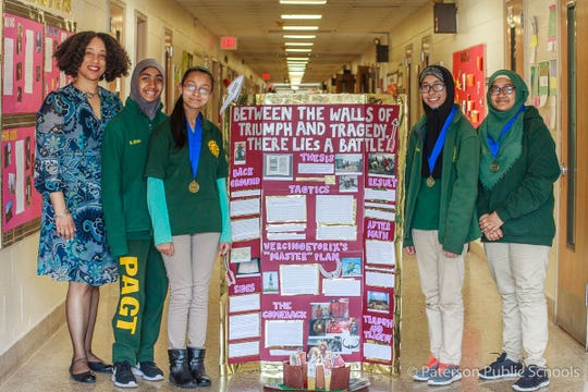 School 28 National History Day finalists - teacher Lizandaa Alburg  (left) with students (from left to right) Salma Ullah, Naima Bari,  Jakiah Choudhury, and Afsara Ahmed