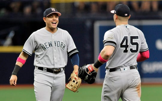 New York Yankees' Gio Urshela, left and Luke Voit, right, celebrate a 7-1 win over the Tampa Bay Rays on Sunday, May 12, 2019, in St. Petersburg, Fla. The Yankees won the three-game set, 2-1.