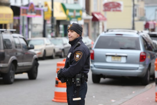 Paterson police officer Frank Toledo patrols on Main St. in Paterson on Dec. 21, 2014.