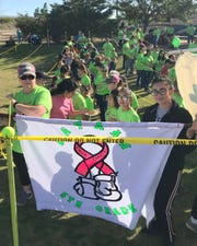 Fifth-grade students from Bataan Elementary School proudly displayed their award-wining flag during the 14th annual Celebration of Life Cancer Walk in Deming, NM.