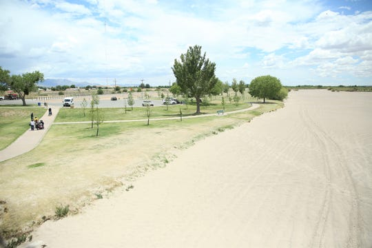 As seen Monday, May 13, 2019 by La Llorona Park in Las Cruces, the Rio Grande in southern New Mexico remains dry this spring, as irrigators await this year's snowmelt run-off to begin releasing water for farmers from Elephant Butte Lake and Caballo Reservoir. The first release from Caballo Reservoir is tentatively slated for May 31, 2019.