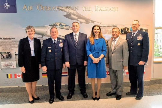 Secretary of the Air Force Heather Wilson, Air Force Chief of Staff Gen. David L. Goldfein, Mr. Muharren Alija, Vlora 'itaku, the Ambassador of the Republic of Kosovo, Retired Lt. Gen. Dan Leaf, and Brig. Gen. Chris Short pose for a photo in front of a display commemorating the 20th Anniversary of Operation Allied Force during a ceremony at the Pentagon in Washington, D.C., May 8.
