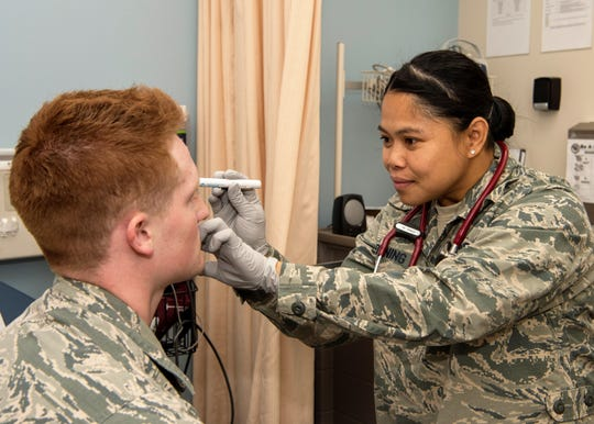1st Lt. Mary Joanne Browning, 49th Medical Group registered nurse, checks the vision of Airman 1st Class Marcus Pyle, 49th MDG technician, May 6, 2019, at the Medical Clinic on Holloman Air Force Base, N.M. Browning has been working as a registered nurse at the medical clinic for three years.