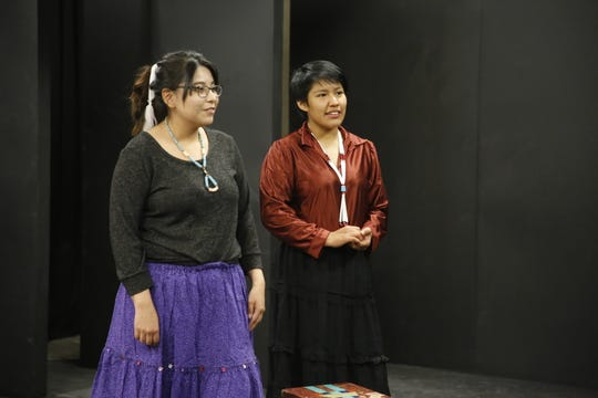 Newcomb High School students Arianna Happy, left, and Zhoniba Belone perform in a play on May 13 at Newcomb High School.