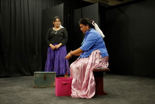 Newcomb High School students Arianna Happy, left, and Khaliyah Keedah perform in the first play by their theater class on May 13 in Newcomb.