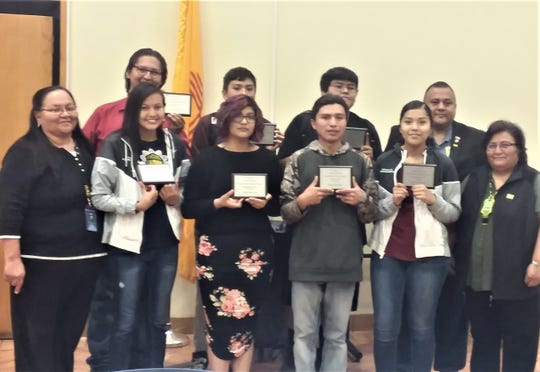 """Native American Student of the Year""  awards in back row went to sophomore Keithan Pedro, freshman Jameson Morgan, junior Fidel Notsinneh with Mescalero Apache Tribe Vice-President Gabe Aguilar. In front from left are Native American Liaison, Char Bigmouth, senior Quinlynn Antonio, sophomore Tristan Largo, senior Kyler Blaylock, freshman Camryn Casares with MAT Council member:Gina Cochise."