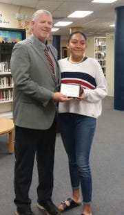 "RHS Junior Bailey Magoosh received ""Native American Student of the Year"" from Principal Cody Patterson."