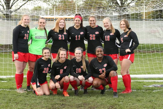 Canton's seniors pose after defeating Hartland on senior day.