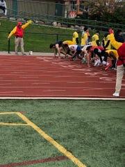 Northville's Zack Phillips (lane 5) just before start of 100m dash.