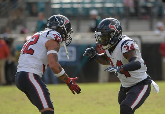 Houston Texans defensive back Mike Tyson (34) and free safety Tyrann Mathieu (32) celebrate a play against the Jacksonville Jaguars last season. (AP Photo/Phelan M. Ebenhack)
