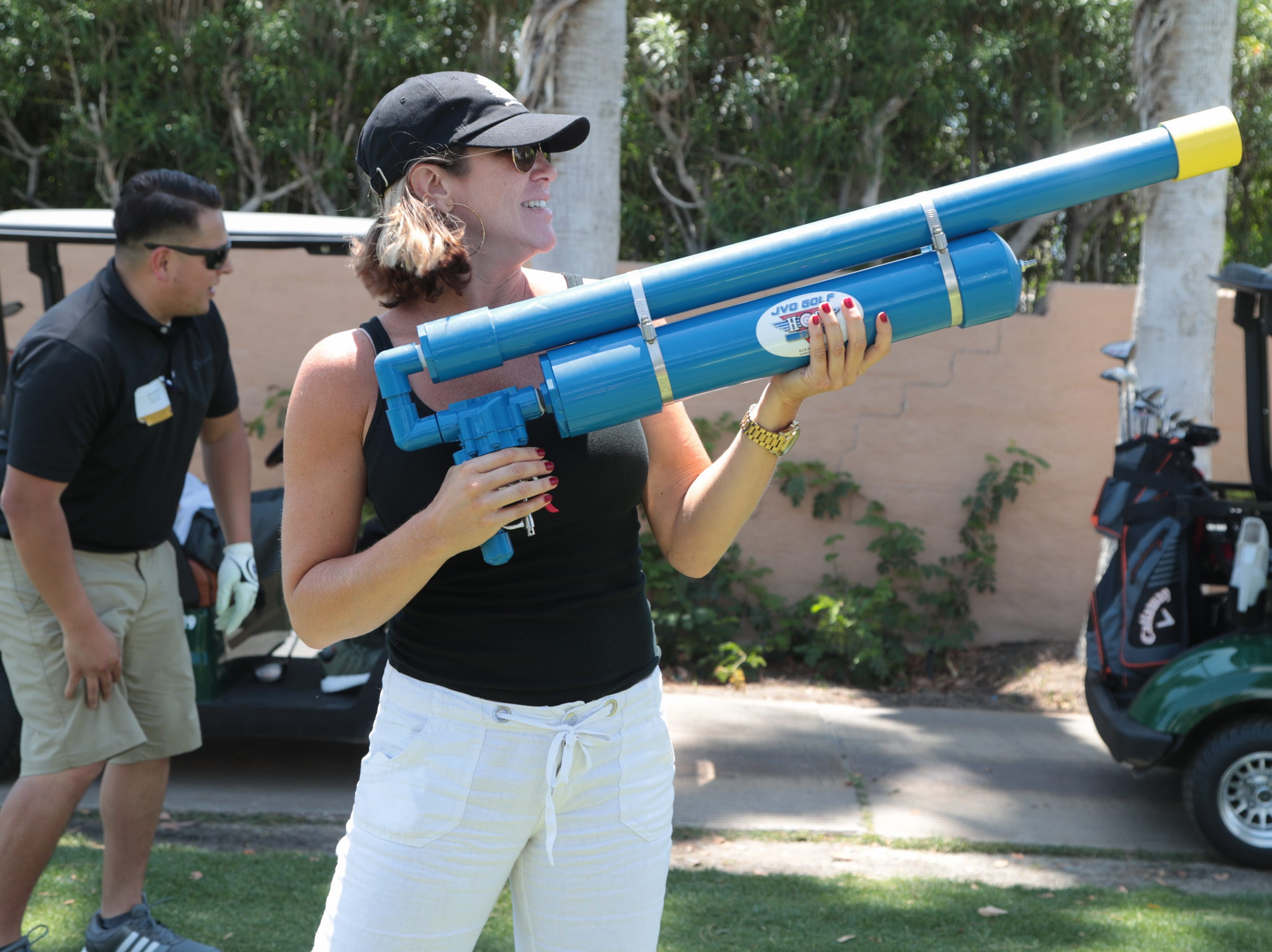 Melissa Costa shoots a golf ball in place of teeing off at the Coachella Valley Cannabis Alliance Network's charity golf tournament, Palm Desert, Calif., May 11, 2019.