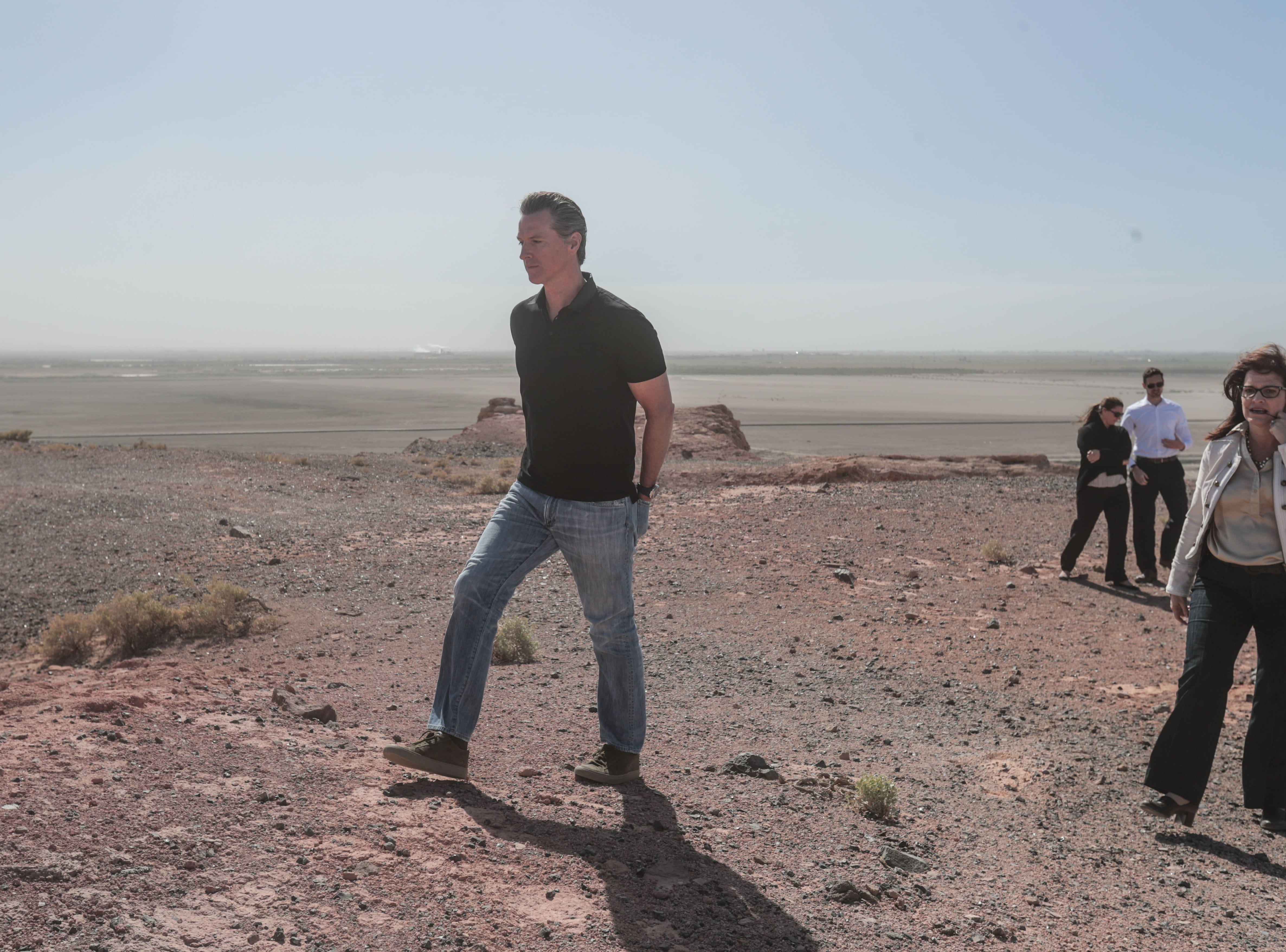 Gavin Newsom looks at areas around the Salton Sea from a hilltop in Calipatria on April 19, 2018. Newsom, who was then lieutenant governor, heard about ecological, environmental, and public health challenges facing the region on his visit.