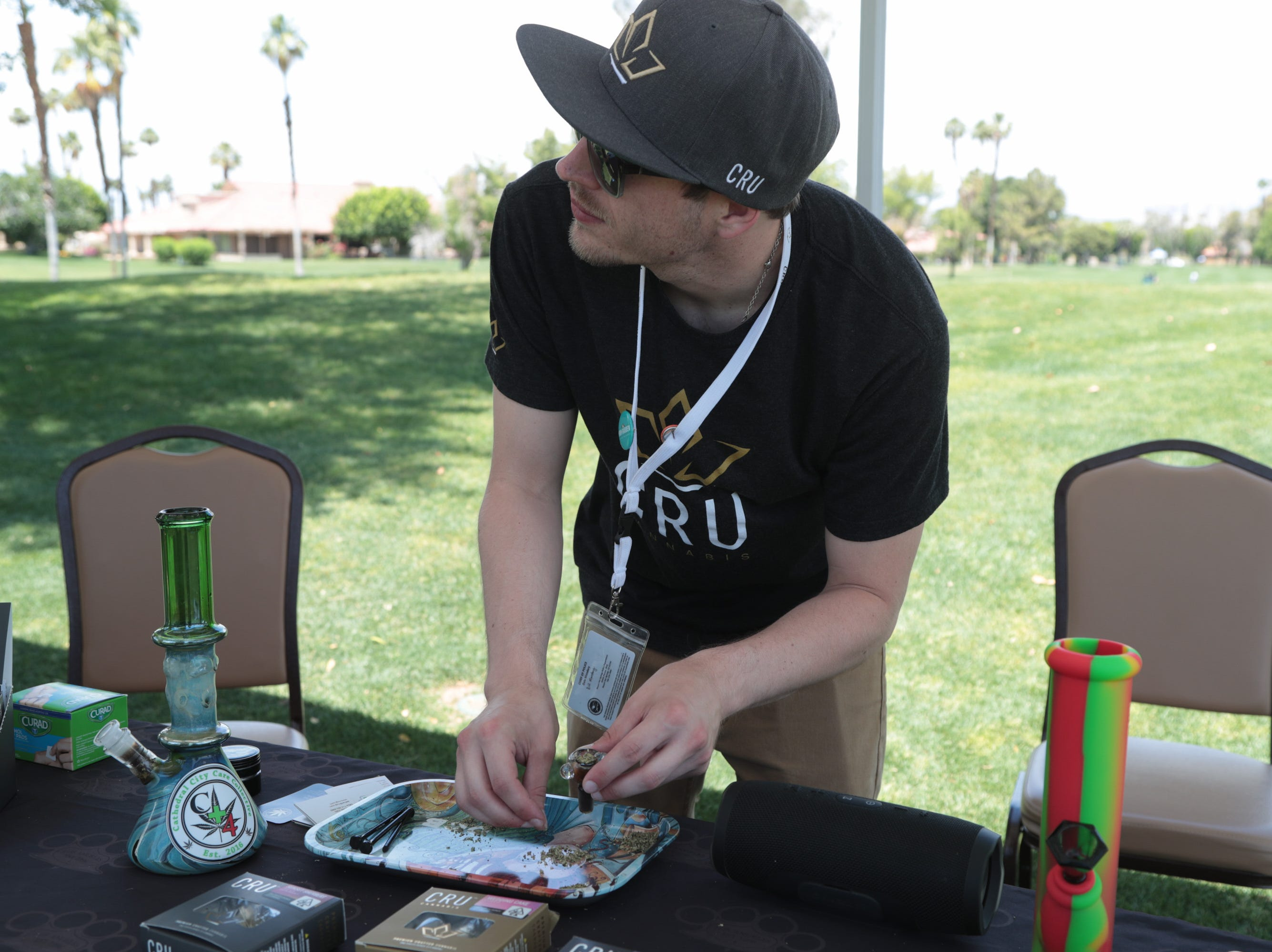 Ryan Pasos from Cru Cannabis packs a bowl for a golfer at the Coachella Valley Cannabis Alliance Network's charity golf tournament, Palm Desert, Calif., May 11, 2019.