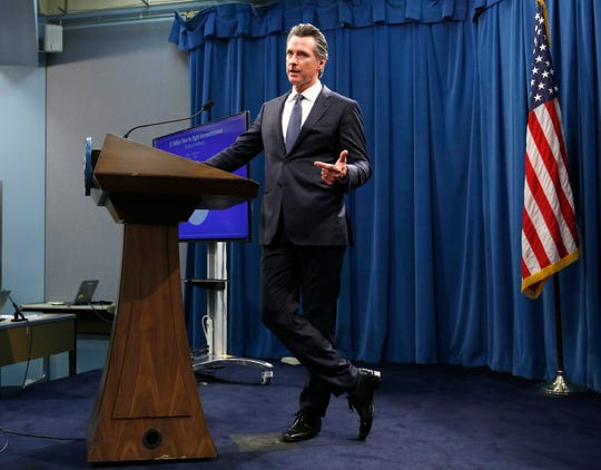 Gov. Gavin Newsom discusses his revised 2019-2020 state budget during a news conference Thursday, May 9, 2019, in Sacramento.
