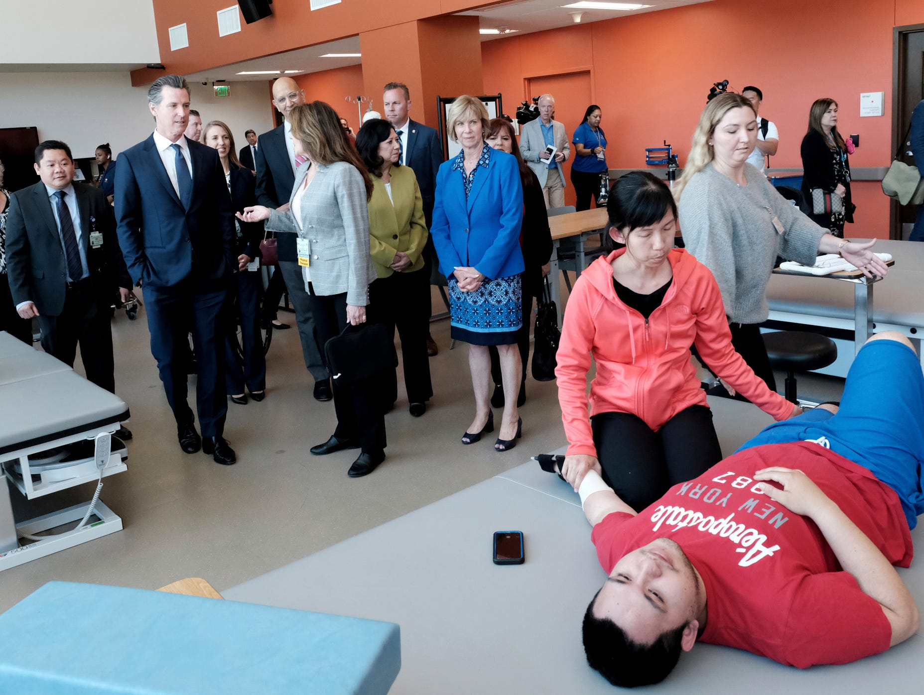 Gov. Gavin Newsom, second from left, visits the Rancho Los Amigos National Rehabilitation Center in Downey on Wednesday, April 17, 2019.