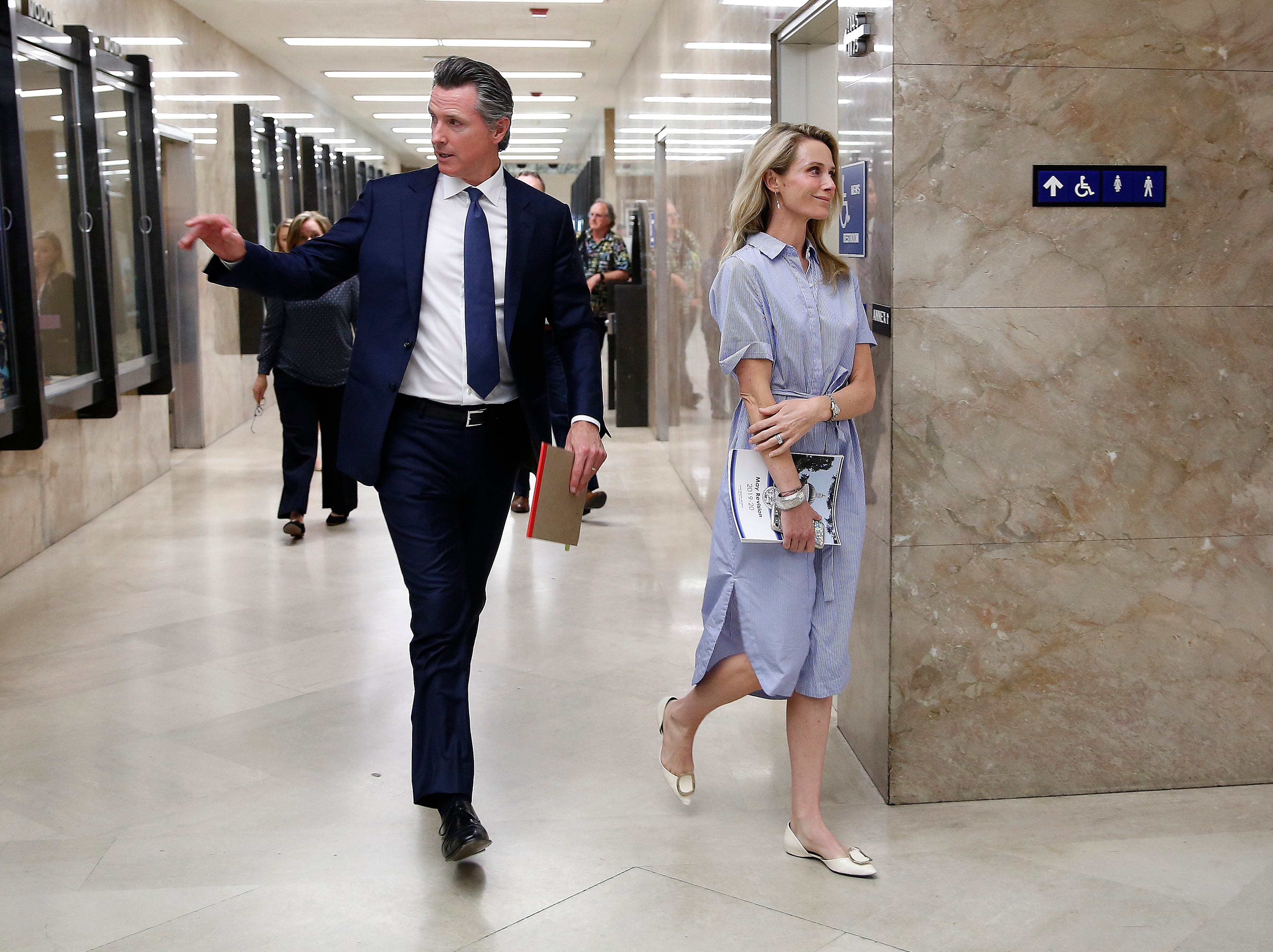 Gov. Gavin Newsom and his wife, First Partner Jennifer Siebel Newsom, return to the Governor's Office after he unveiled his revised 2019-2020 state budget at a news conference Thursday, May 9, 2019, in Sacramento.