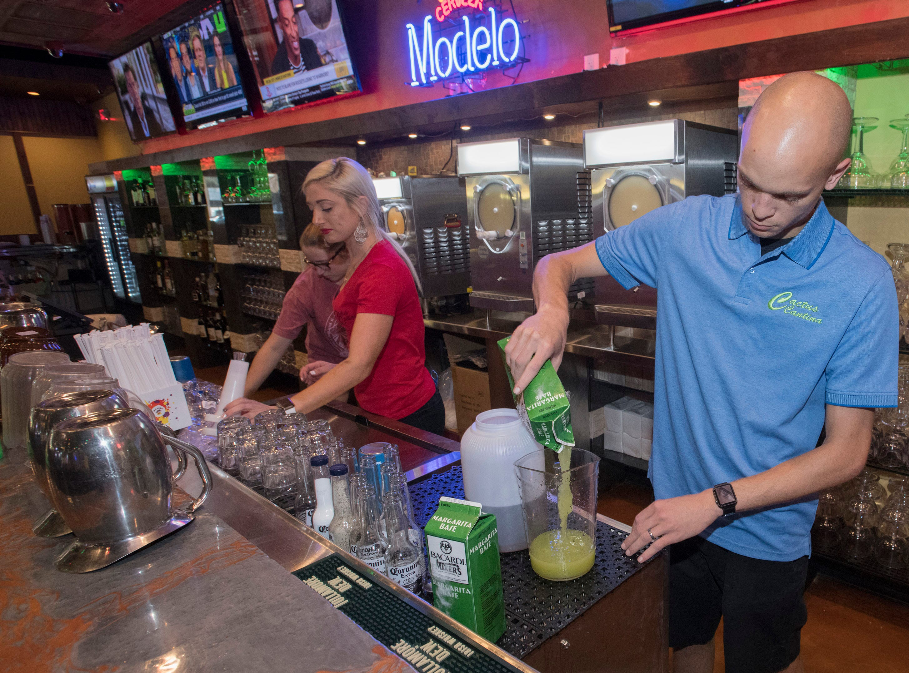Jay Putnam, the asst. general manager, of the new Cactus Cantina, in downtown Pensacola prepares the restaurants signature margarita mix for a private party on Monday, May 13, 2019. The Mexican restaurant is slated to open to the public on Wednesday.