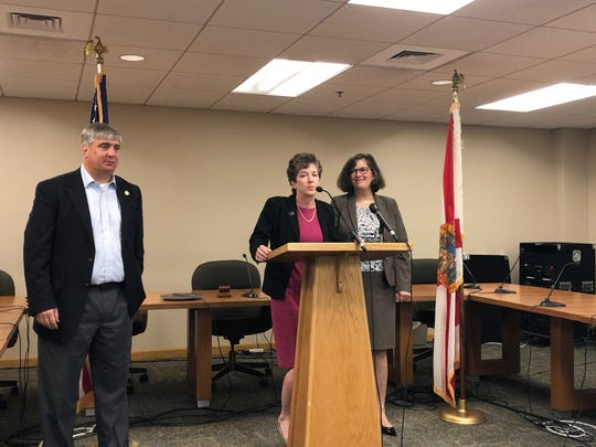 Pensacola Mayor Grover Robinson, left, and City Attorney Susan Woolf, center, introduce Heather Lindsay as the new assistant city attorney for Pensacola during a press conference Monday at Pensacola City Hall. Lindsay is also the Milton mayor.