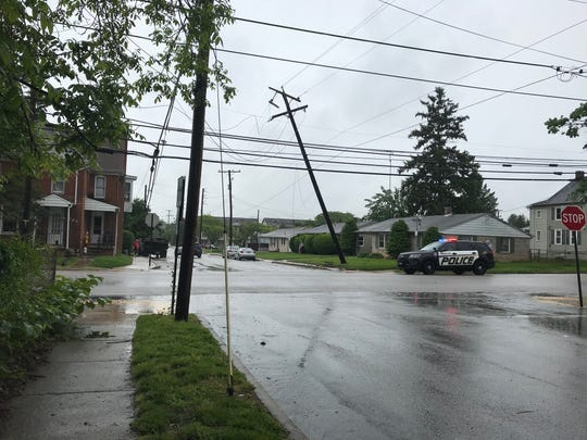 Police are on scene at a fallen power line on May 13 at Broadway and McKinley Avenue.