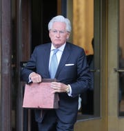 Woodstock 50 lawyer Marc Kasowitz leaves the courthouse in Manhattan on Monday.