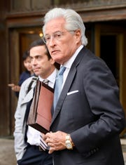 Woodstock 50 lawyer Marc Kasowitz stands outside of the courthouse in Manhattan on Monday.