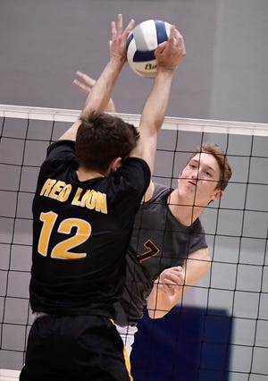 Northeastern's Alex Finch attempts to smash the ball past Red Lion blocker Blake Hildebrand during the York-Adams League boys' volleyball semifinal game, Monday, May 13, 2019.John A. Pavoncello photo
