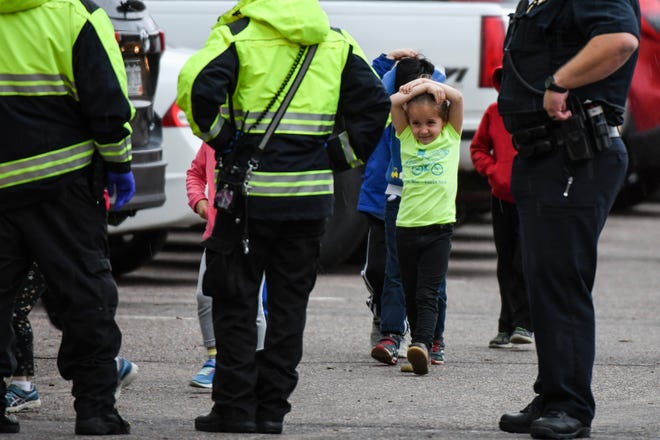 Students get off buses after being evacuated to the Recreation Center at Northridge after one student was killed and at least eight others were injured during a shooting at STEM School Highlands Ranch on May 7, 2019, in Highlands Ranch, Colo.