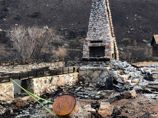 This October 2018 photo provided by the Elko Lion's Club, shows the fireplace and chimney, the only thing remaining from the historic Warner Whipple Lodge in Lamoille Canyon, Nev., that was destroyed on Sept. 30, 2018, in an explosive wildfire that leveled most of an 80-year-old youth camp in the Ruby Mountains southeast of Elko. Volunteers plan to return to the Lion's Club's Camp Lamoille in June to begin a $1 million rebuilding effort. (Chuck Stout/Elko Lion's Club via AP)