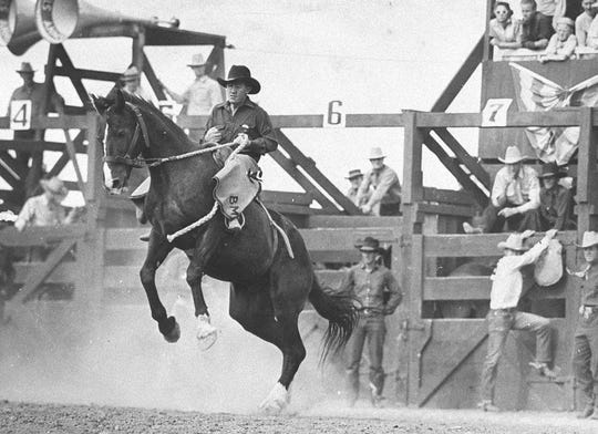 Burrel Mulkey, the 1937 world champion in saddle bronc, rides his bronc at the 1937 Reno Rodeo, a title he also claimed.