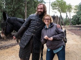 """""""Game of Thrones"""" Executive Producer Bernie Caulfield smiles for a photo with actor Rory McCann, who plays Sandor """"The Hound"""" Clegane on the show. Caulfield is a Bishop Kearney graduate and grew up in Rochester before moving to Los Angeles in her twenties."""