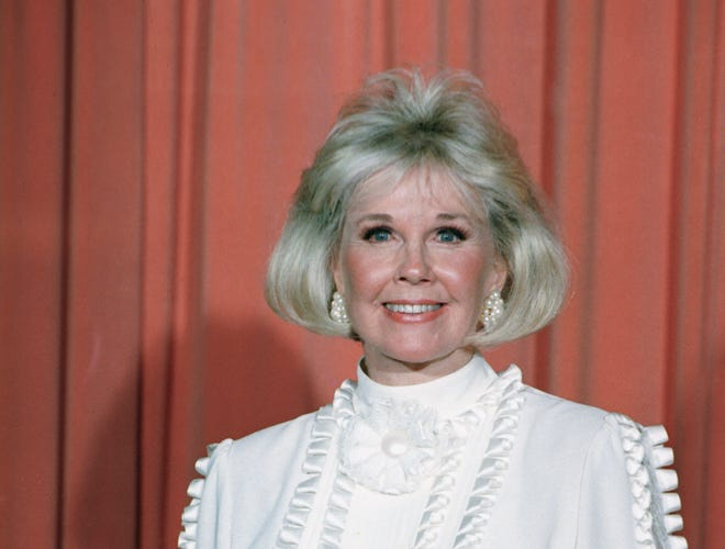 FILE - In this Jan. 28, 1989 file photo, actress and animal rights activist Doris Day poses for photos after receiving the Cecil B. DeMille Award she was presented with at the annual Golden Globe Awards ceremony in Los Angeles. Day, whose wholesome screen presence stood for a time of innocence in '60s films, has died, her foundation says. She was 97. The Doris Day Animal Foundation confirmed Day died early Monday, May 13, 2019, at her Carmel Valley, California, home. (AP Photo, File)