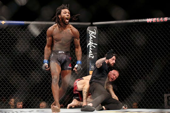 Rush-Henrietta graduate Desmond Green (blue gloves) celebrates his win over Ross Pearson (red gloves) during UFC Fight Night at Wells Fargo Arena on March 30 in Philadelphia. Green will fight on Saturday night at Blue Cross Arena at the Rochester Community War Memorial.