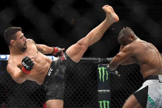 Rafael Dos Anjos (red) fights Kamaru Usman (blue) during the main event welterweight bout on Nov. 30, 2018 at The Pearl in Las Vegas. Dos Anjos will take on Kevin Lee in Rochester on Saturday night.