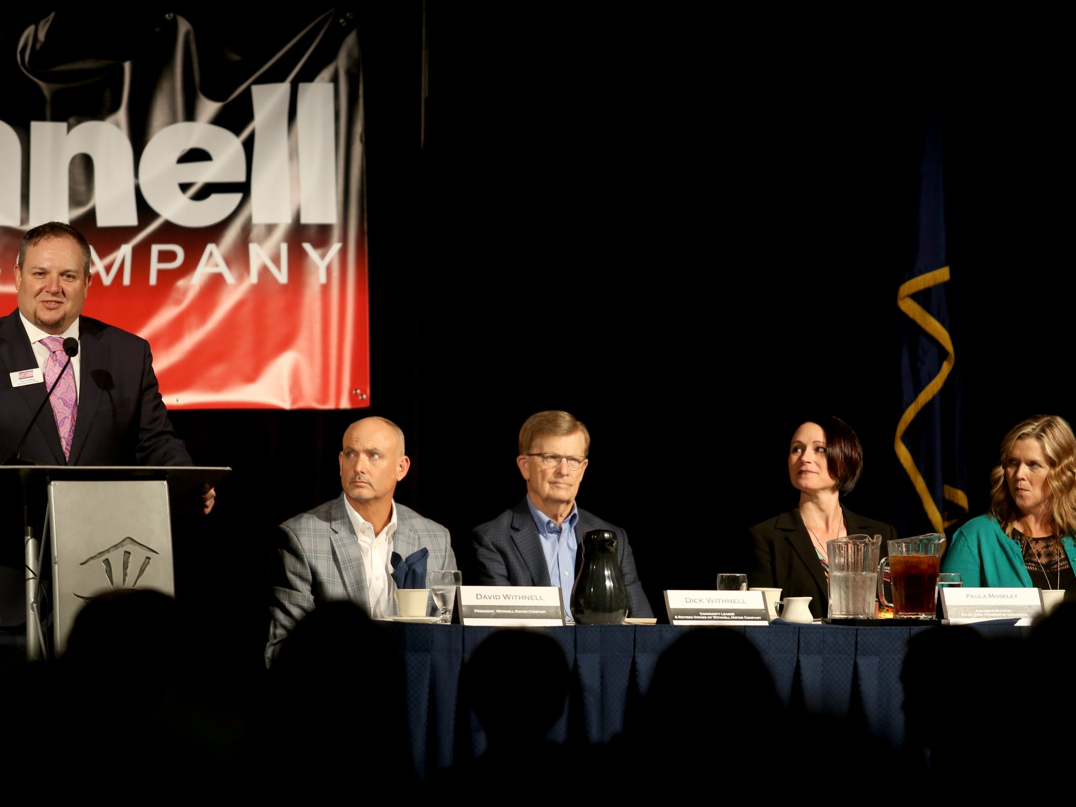 Tom Hoffert, from left, the chief executive officer of the Salem Area Chamber of Commerce, speaks as David Withnell, Dick Withnell, Paula Moseley and Barb Bamford sit at the head table during the Salem Area Chamber of Commerce monthly Forum Speaker Series at the Salem Convention Center on May 13, 2019.