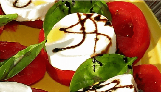 Caprese salad with balsamic reduction.